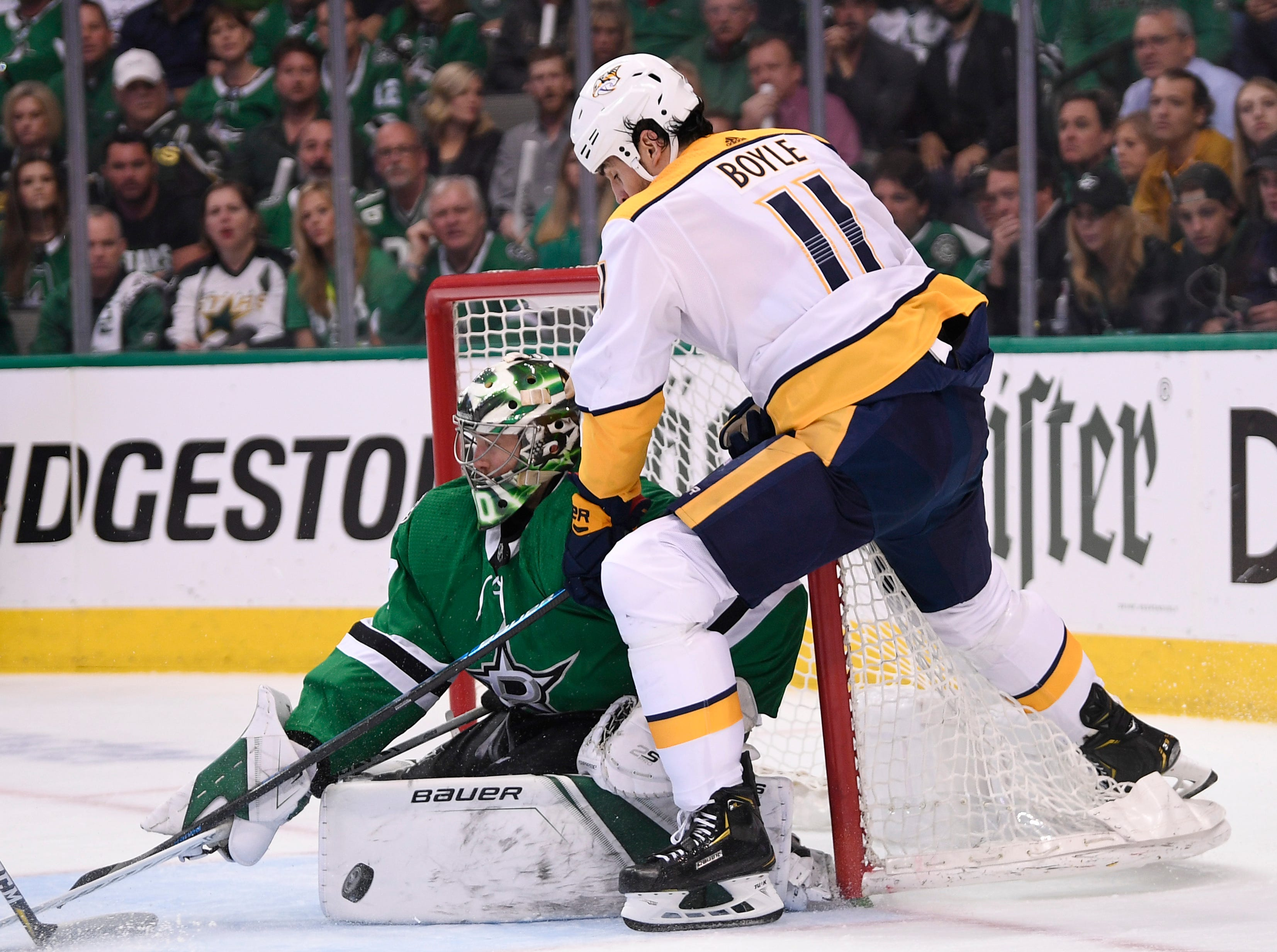 Nashville Predators center Brian Boyle (11) shoots into Dallas Stars goaltender Ben Bishop (30) during the first period of the divisional semifinal game at the American Airlines Center in Dallas, Texas, Monday, April 22, 2019.