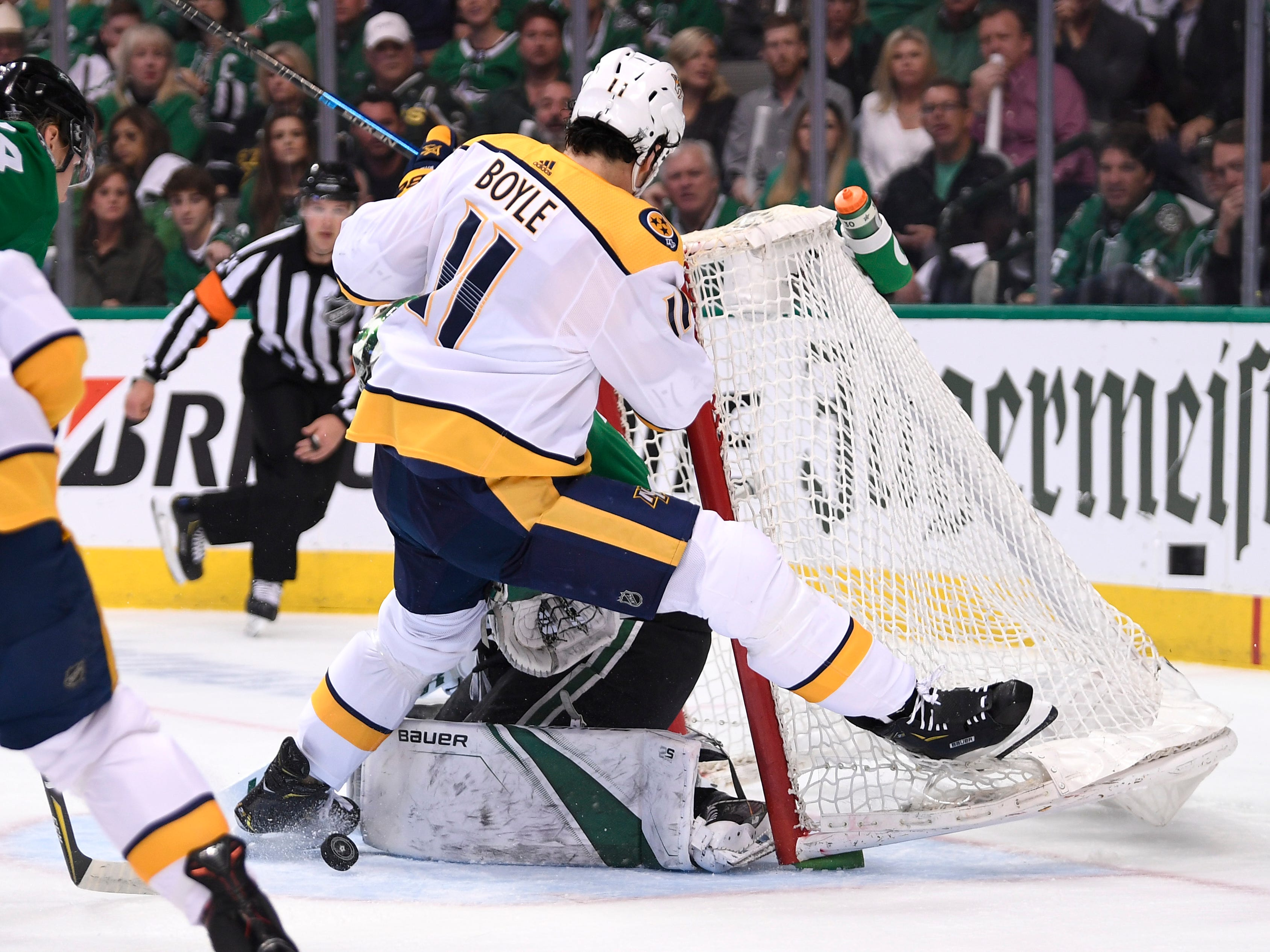 Nashville Predators center Brian Boyle (11) battles in front of Dallas Stars goaltender Ben Bishop (30) as the net comes off during the first period of the divisional semifinal game at the American Airlines Center in Dallas, Texas, Monday, April 22, 2019.
