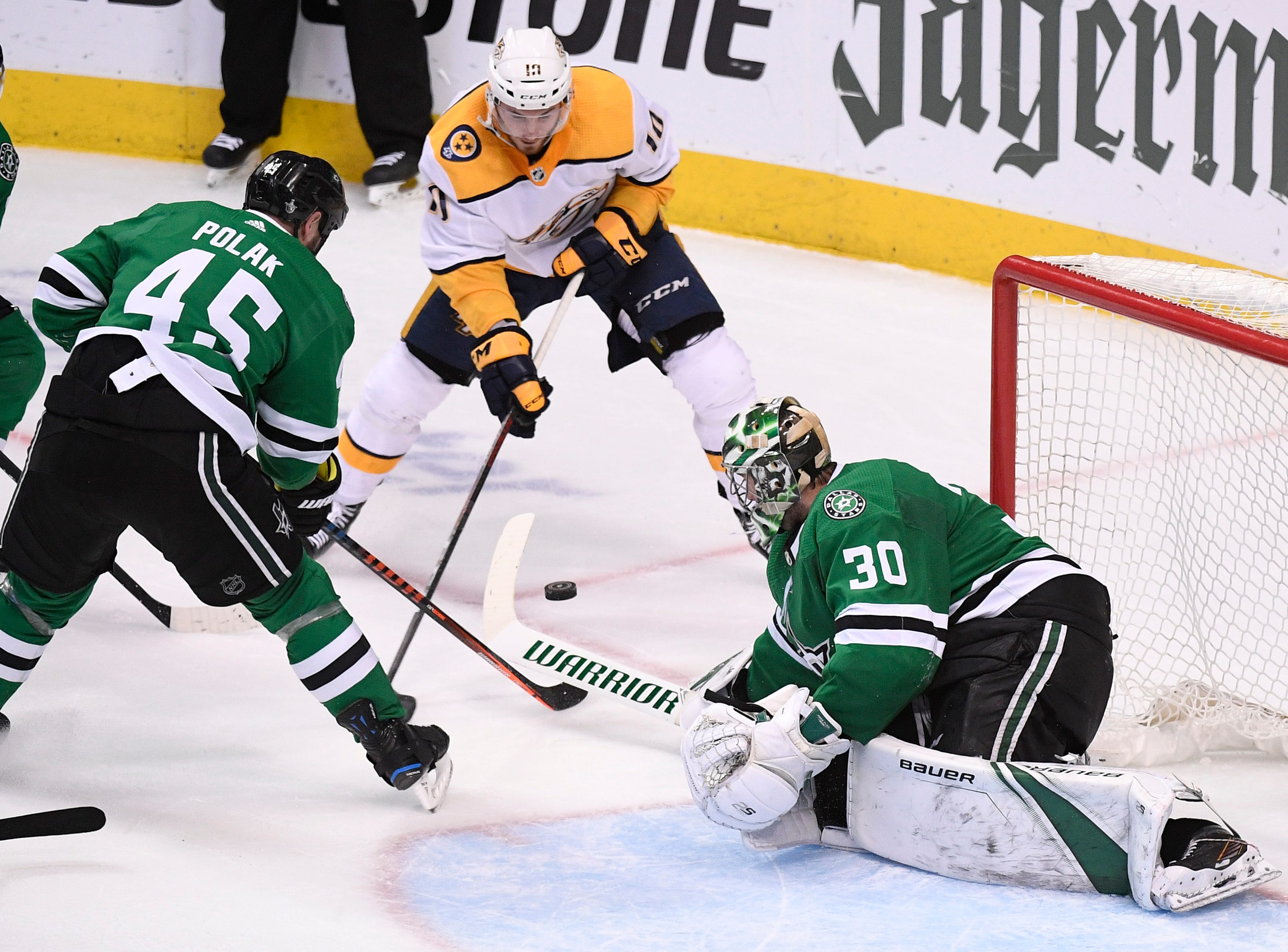 Nashville Predators center Colton Sissons (10) shoots on Dallas Stars goaltender Ben Bishop (30) as Stars defenseman Roman Polak (45) defends during the third period of the divisional semifinal game at the American Airlines Center in Dallas, Texas, Monday, April 22, 2019.