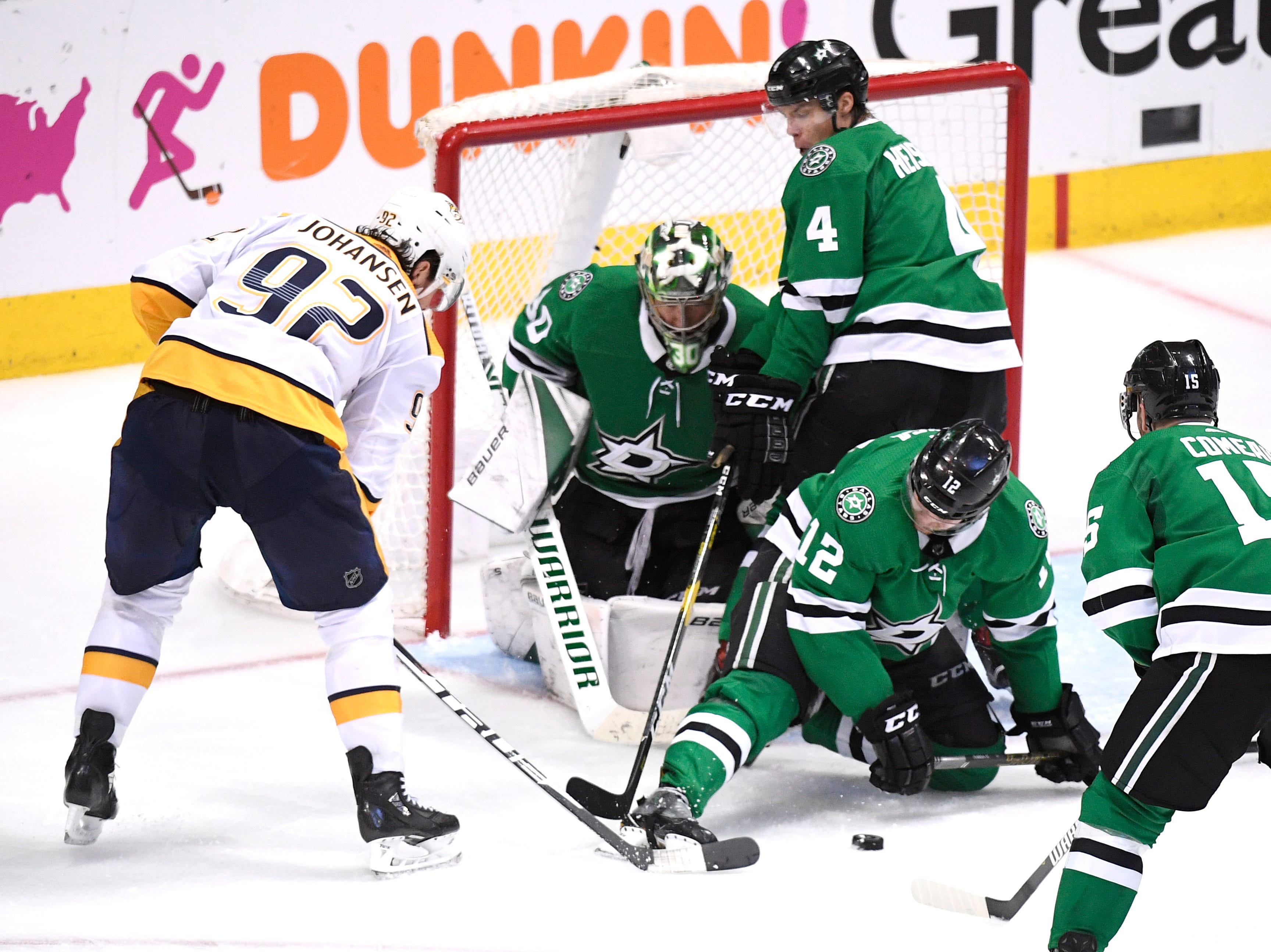 Dallas Stars goaltender Ben Bishop (30) defends the net as Nashville Predators center Ryan Johansen (92) tries to score during overtime of the divisional semifinal game at the American Airlines Center in Dallas, Texas, Monday, April 22, 2019.