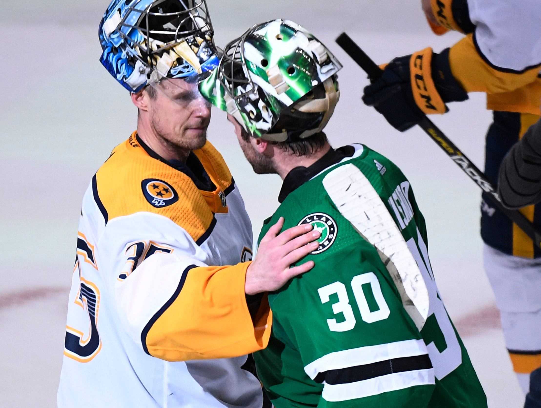 Nashville Predators goaltender Pekka Rinne (35) and Dallas Stars goaltender Ben Bishop (30) share a few words after the Stars won the overtime game and the divisional semifinal series at the American Airlines Center in Dallas, Texas, Monday, April 22, 2019.