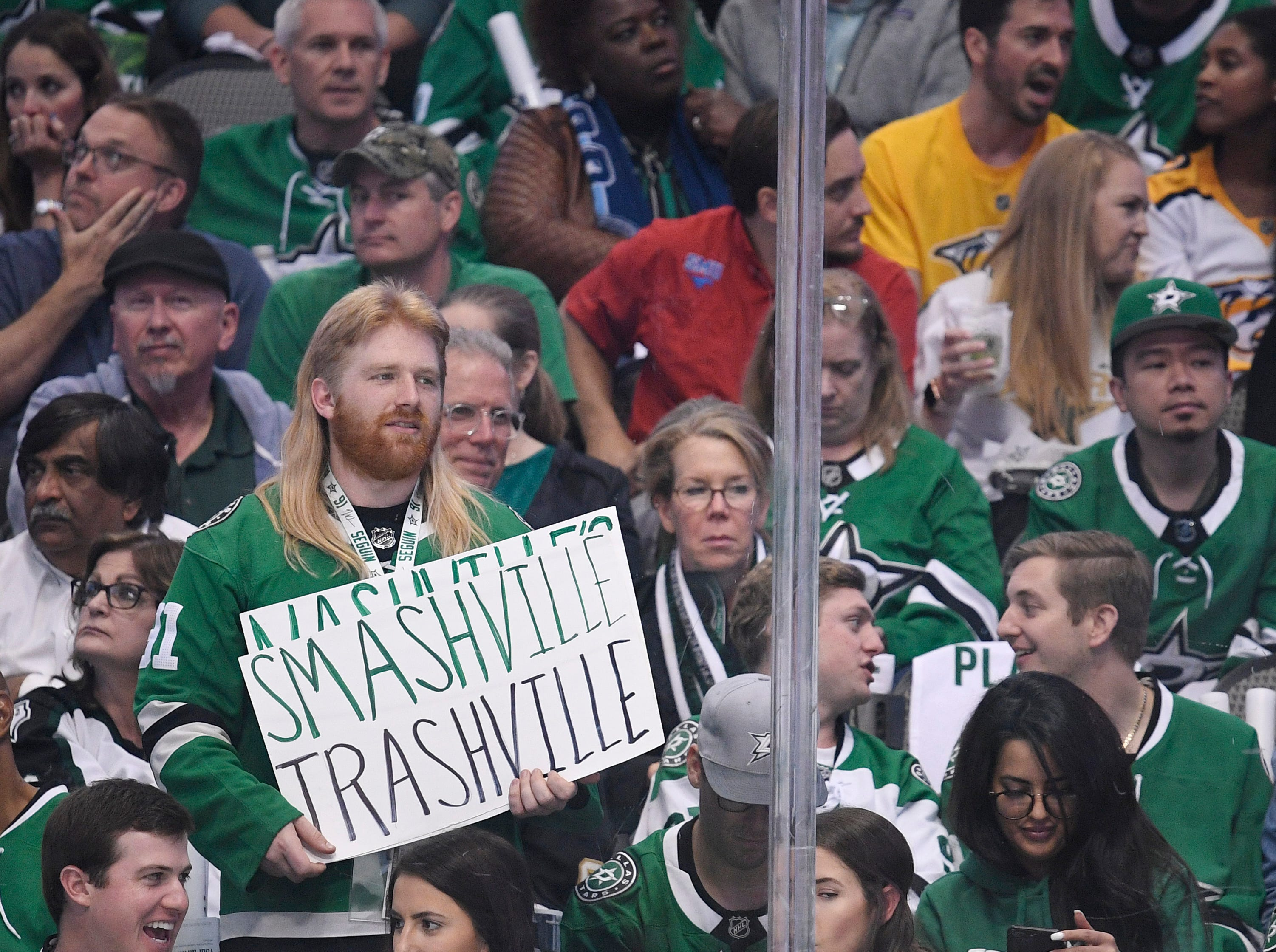 A Dallas Stars fan shares his feelings about the Nashville Predators during the first period of the divisional semifinal game at the American Airlines Center in Dallas, Texas, Monday, April 22, 2019.