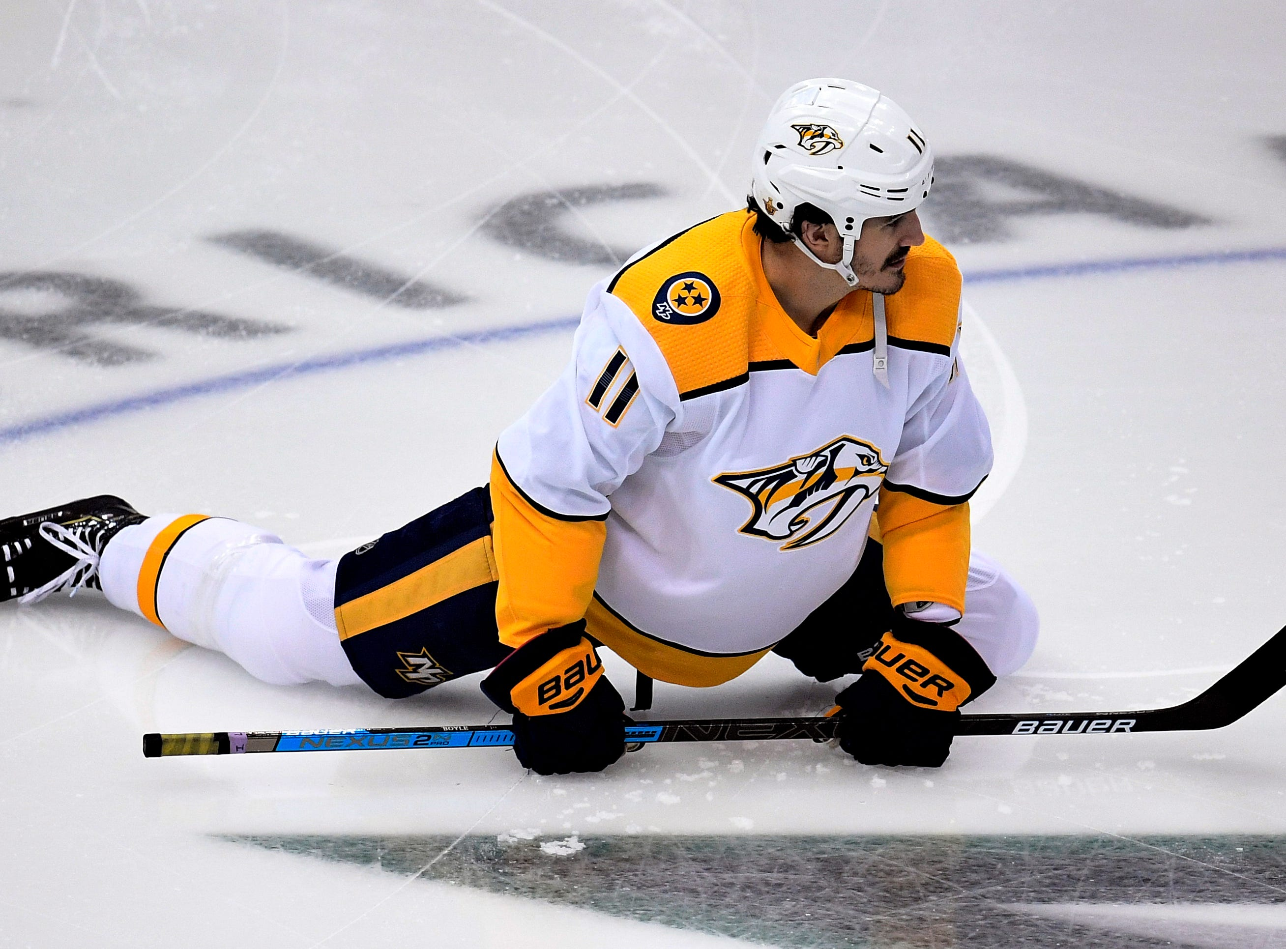 Nashville Predators center Brian Boyle (11) stretches during warmups before the divisional semifinal game against the Dallas Stars at the American Airlines Center in Dallas, Texas, Monday, April 22, 2019.