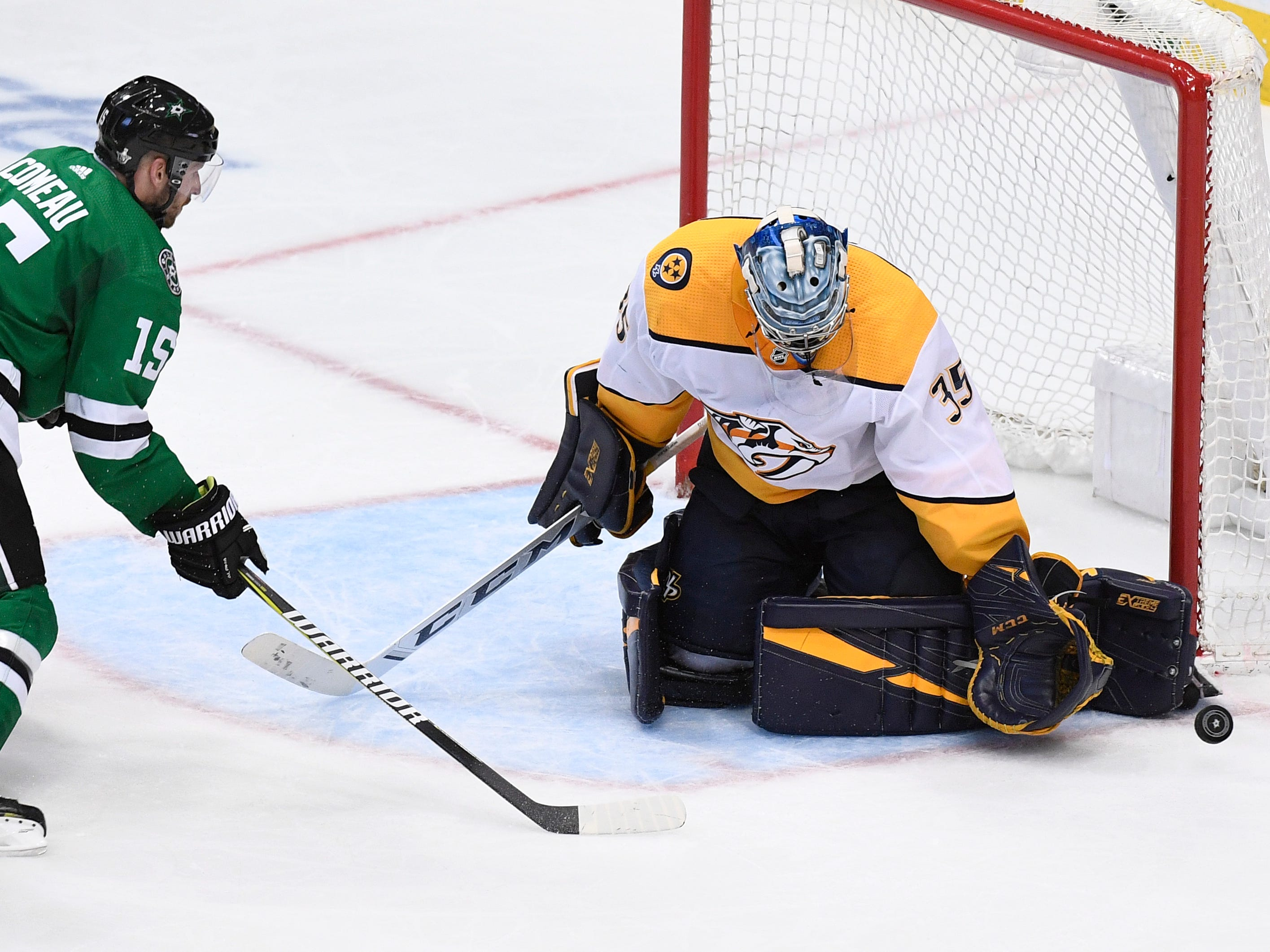 Nashville Predators goaltender Pekka Rinne (35) defends the net in front of Dallas Stars left wing Blake Comeau (15) and Nashville Predators defenseman Mattias Ekholm (14) during overtime of the divisional semifinal game at the American Airlines Center in Dallas, Texas, Monday, April 22, 2019.