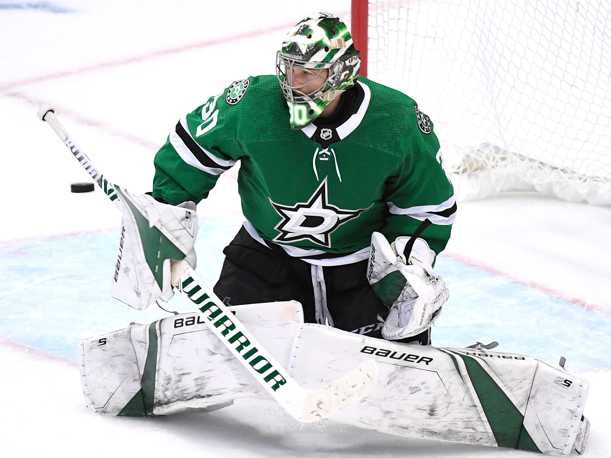 Dallas Stars goaltender Ben Bishop (30) blocks a Predators shot during the third period of the divisional semifinal game at the American Airlines Center in Dallas, Texas, Monday, April 22, 2019.