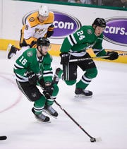 Dallas Stars center Jason Dickinson (16) skates with the puck and left wing Roope Hintz (24) as Nashville Predators center Kyle Turris (8) trails behind during the second period of the divisional semifinal game at the American Airlines Center in Dallas, Texas, Monday, April 22, 2019.