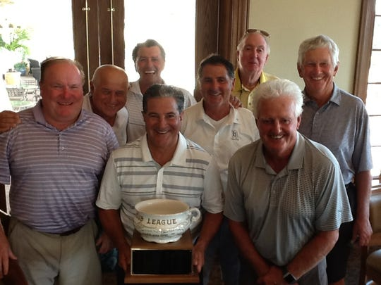 """The TPC Treviso Bay team of Jim Murdoch, Jeff Marks, Rich Rothman, Bob Williams (Captain), Jeff Mazzaro, Ray Dufresne, Kas Oganowski and Pat Fairchild won the coveted """"Old Mug""""  at Pelican's Nest playing against Kensington in the Naples Area Men's Interclub's 49th season."""