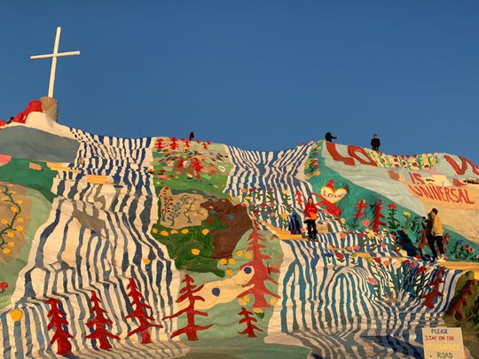 Constructed of cement, adobe, straw, junkyard treasures and thousands of gallons of lead-free paint, the 50-foot-high Salvation Mountain in Niland, California, was conceived, built — and rebuilt — by Leonard Knight, as a tribute to his faith. Outside Palm Springs, California, Jan. 2, 2019
