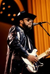 "Entertainer of the Year Hank Williams Jr. holds forth during his solo of the ""from honky-tonk to rock 'n' roll"" segment of the CBS two-hour ""A Country Music Celebration: The 30th Anniversary of the Country Music Association"" special at the Grand Ole Opry House Jan. 7, 1988."