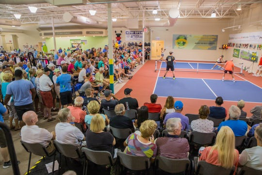 Fans watch a match at the 2018 Pickleball Global Challenge Cup. The Cup returns to the indoor courts at Tennis & Pickleball US in Bonita Springs from Wednesday through Friday, bringing 25 of the highest-ranked players in the world.