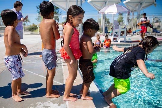 Preschoolers from Sunshine Learning Center line up to jump into the pool during swim lessons at Eagle Lakes Community Park Aquatic Facility in Naples on Tuesday, April 23, 2019. The program is part of a grant through NCH Safe and Healthy Children's Coalition of Collier County, funded by the Naples Children and Education Foundation.