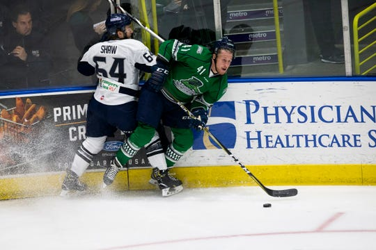 Florida Everblades forward Blake Winiecki fights for the puck during Game 6 of the ECHL Kelly Cup Playoffs South Division Semifinals against the Jacksonville Icemen at Hertz Arena on Monday. The Everblades beat the Icemen 5-1.