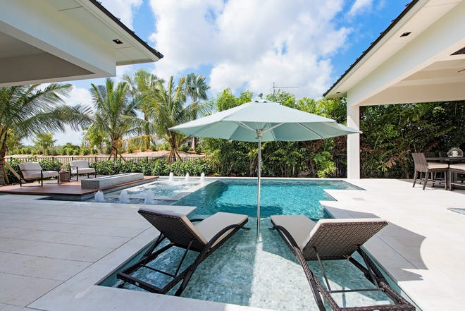 KTS Homes' Newport model in Naples Reserve features a pool with a wet shelf, a trendy addition that does not add major costs.