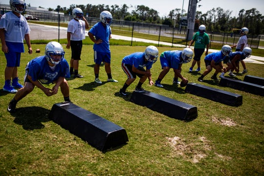 Members of the Bonita Springs High School football team run drills during their first practice of the year on Tuesday, April 23, 2019. This is the first year the school will have a varsity team.