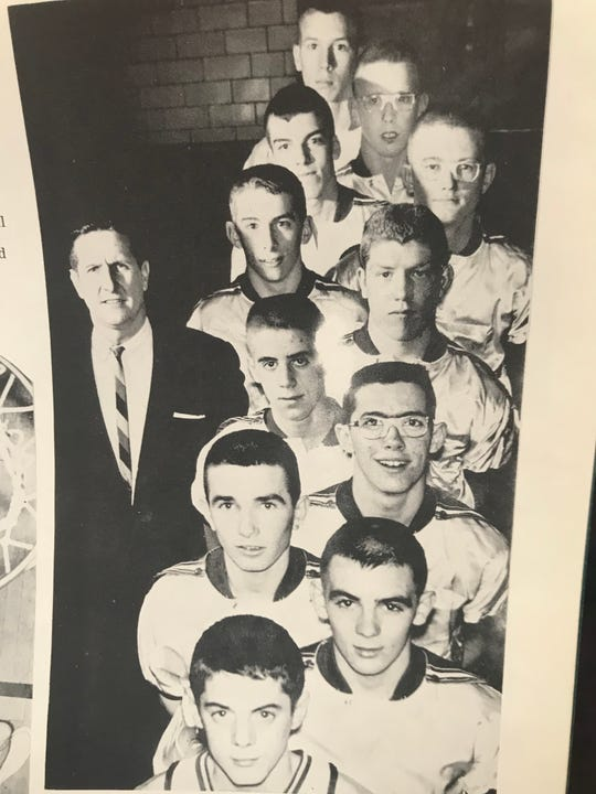 Former Newark Catholic coach Walt Reid, left, is pictured here with his 1962-63 boys basketball team. Reid died April 15.