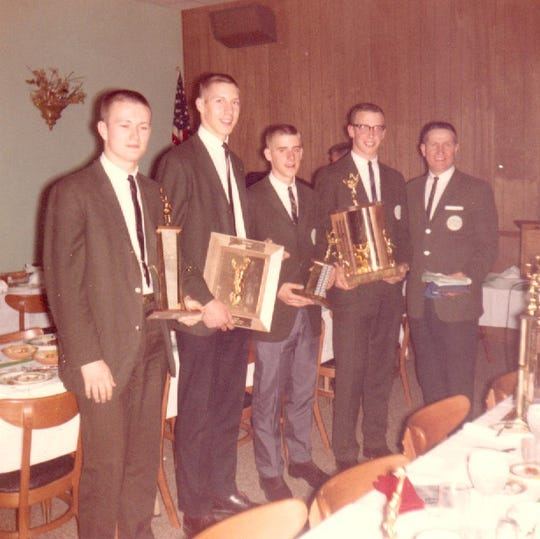 Newark Catholic basketball players John Brown, Bob Gorius, Herb Zureich and Greg Stevens join coach Walt Reid at the team's banquet following the 1963-64 season. Reid, a legendary player and coach at the school, died April 15.