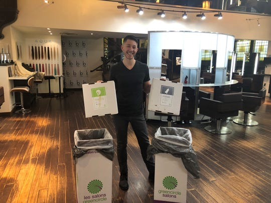 Andy Tipton, a stylist at Bangz Salon and Wellness Spa in Montclair, with the bins containing beauty waste that will be recycled through Green Circle Salons in Toronto.