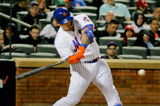 April 22, 2019; New York City, NY, USA; New York Mets catcher Wilson Ramos (40) hits an RBI single against the Philadelphia Phillies during the third inning at Citi Field.