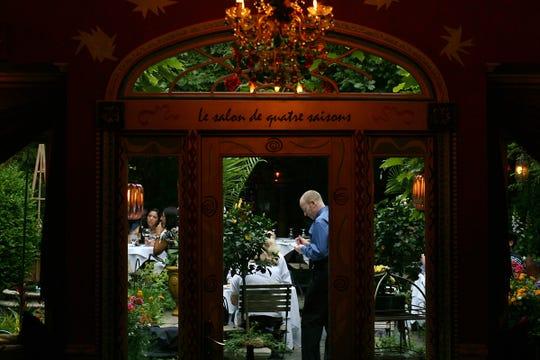 Outdoor dinning at Cafe Matisse in Rutherford. (center) Server Stephen DeSantis.  MICHAEL KARAS / STAFF PHOTOGRAPHER