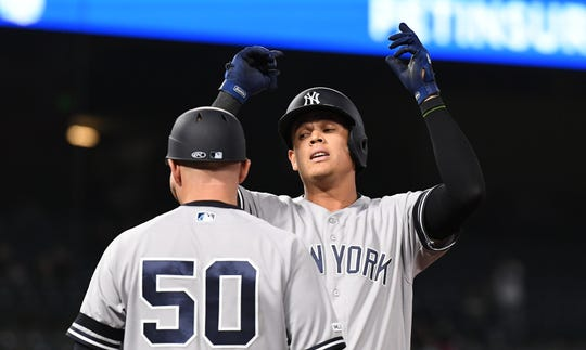 April 22, 2019; Anaheim, CA, USA; New York Yankees third baseman Gio Urshela (29) celebrates after hitting an RBI single in the fourteenth inning against the Los Angeles Angels at Angel Stadium of Anaheim.