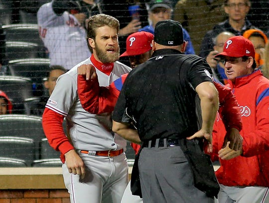 April 22, 2019; New York City, NY, USA; Philadelphia Phillies right fielder Bryce Harper (3) argues a strike call and is ejected by home plate umpire Mark Carlson against the New York Mets during the fourth inning at Citi Field.