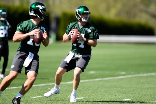 New York Jets quarterbacks Trevor Siemian, left, and Sam Darnold, right, participate in drills during practice on Tuesday, April 23, 2019, in Florham Park.
