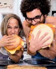 Blake Horton (aka Blake_201) eating giant McGriddles with his girlfriend Jenni (aka BigJenni)