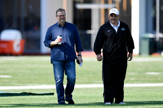 New York Jets general manager Mike Maccagnan, left, is seen on the field during practice on Tuesday, April 23, 2019, in Florham Park.
