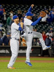 April 22, 2019; New York City, NY, USA; New York Mets first baseman Dominic Smith (22) and third baseman Todd Frazier (21) react after defeating the Philadelphia Phillies at Citi Field.