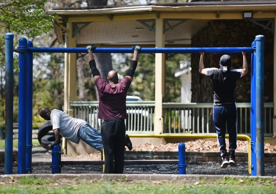 Three men work out at Eastside Park in Paterson on 04/23/19.