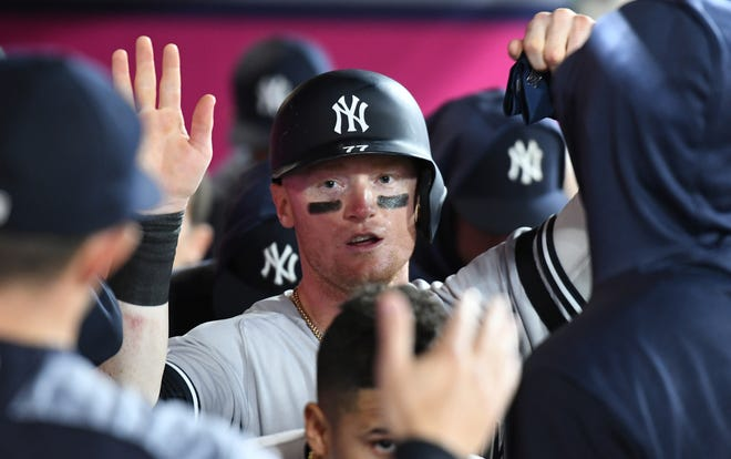 April 22, 2019; Anaheim, CA, USA; New York Yankees left fielder Clint Frazier (77) celebrates after scoring in the twelfth inning against the Los Angeles Angels at Angel Stadium of Anaheim. Mandatory Credit: Richard Mackson-USA TODAY Sports