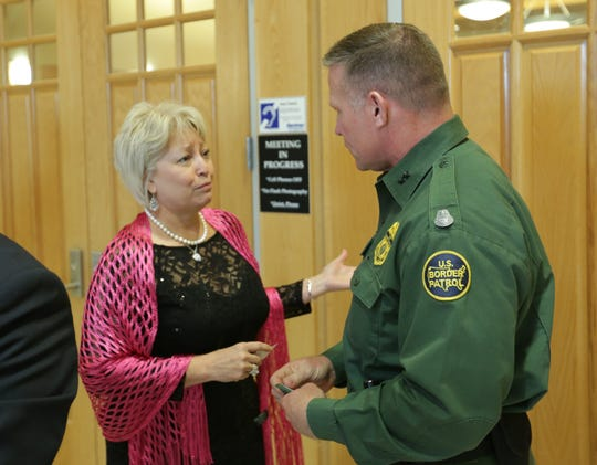 Doña Ana County Commissioner Isabella Solis, left, speaks on Tuesday, April 23, 2019 with Chief Patrol Agent Aaron Hull of the U.S. Border Patrol's El Paso Sector. Hull addressed commissioners during a regular meeting at the county building, 845 N. Motel Blvd., Las Cruces.