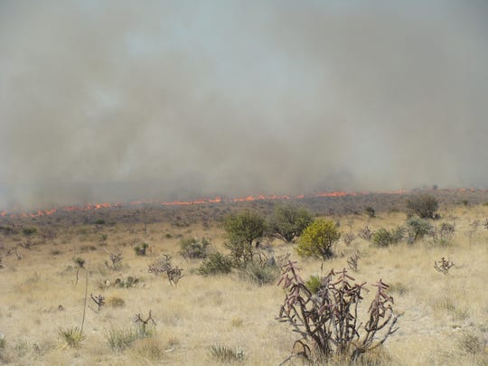 The 2009 Fire Mile Four burns in Chaves County.