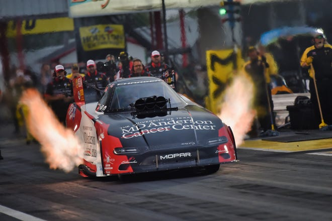 Jack Beckman drives the MD Anderson Cancer Center racecar during the DSR Houston MOPAR Express Lane NHRA SpringNationals. The car paint job was to honor Doug Chandler's late wife Terry, who died from brain cancer in 2017.