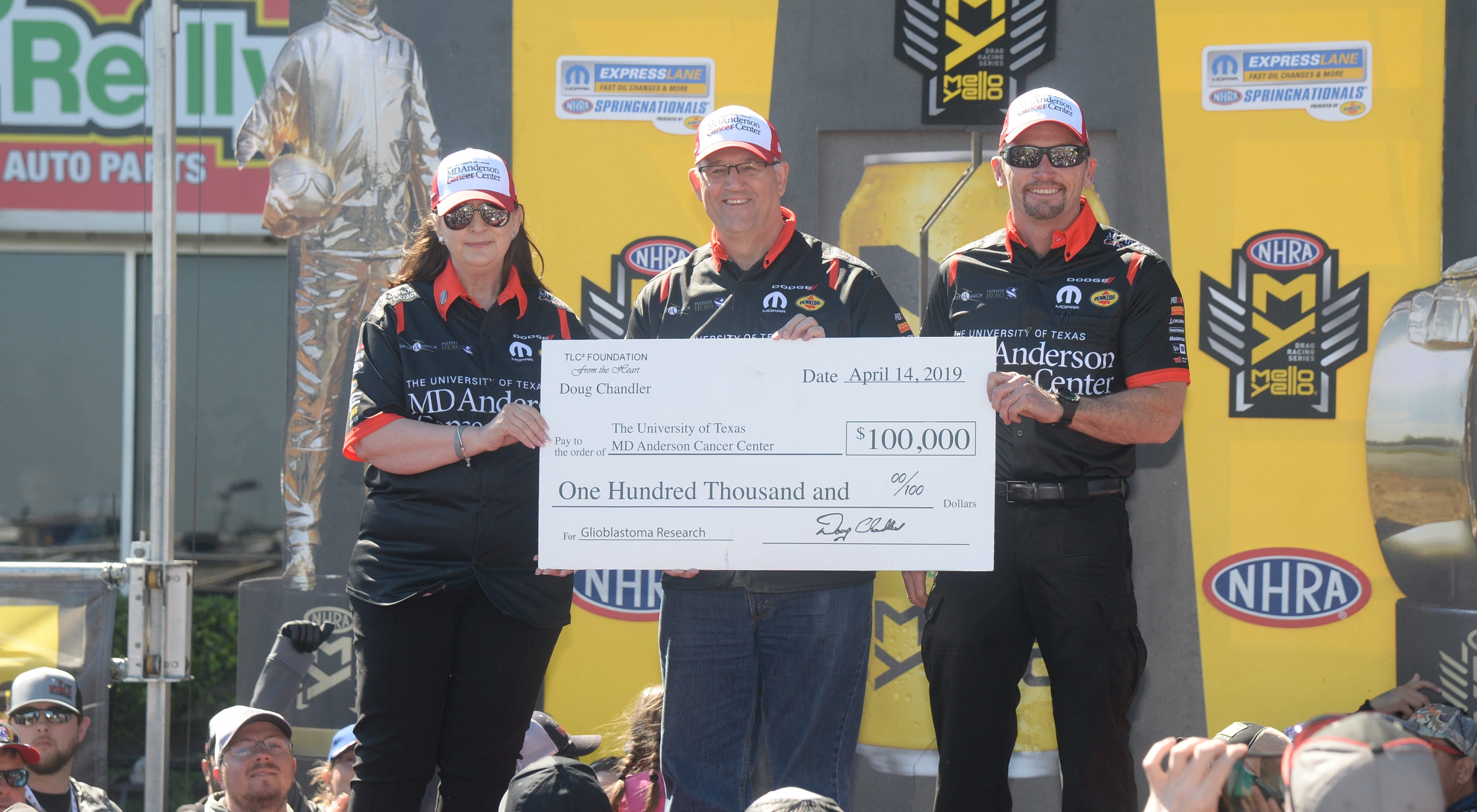 Left to right Judy Pittman , Bobby Dean and Jack Beckman present $100,000 donation check to the MD Anderson Cancer Center, on behalf of Doug Chandler and his TLC Foundation in honor of Doug Chandler's late wife, Terry Chandler.