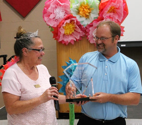 The 2018-2019 Helen Kirk Award went to Penina Nunnelley of the Fraternal Order of Eagles. It was presented to her by last year's winner  Tularosa Basin Telephone Company general manager Josh Beug.