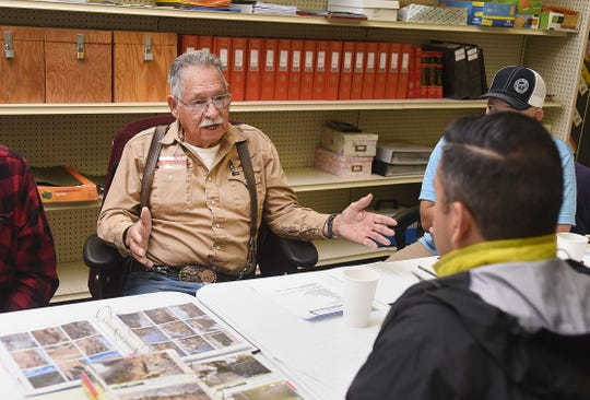 The Bloomfield Irrigation District and the City of Bloomfield are working together on improving the district's ditch and have settled a rate dispute. District board member Leonard Trujillo talks with Rep. Ben Ray Luján, D-NM, on Tuesday Nov. 22, 2016, at the irrigation district's office in Bloomfield in this file photo.