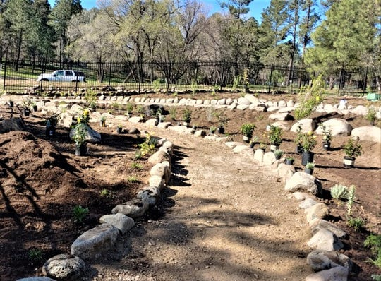 Walkway will protect plants from being damaged in the new botanical garden.