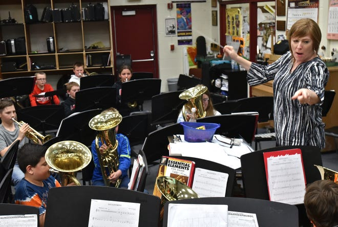 Muir Middle School teacher Kristin Blanchard, right, leads band class through practice during pre-pandemic life.