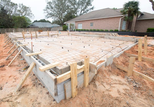 A house under construction on Autumn Breeze Circle in Gulf Breeze is pictured Tuesday. The Santa Rosa CountySchool District board will vote Thursday on whether to ask the county to re-institute impact fees to pay for new school construction.