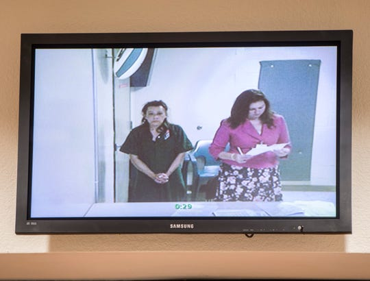 Marie Ann Simpkins, left, makes her first appearance Tuesday before Judge Jennifer Frydrychowicz via video at the  Escambia County Courthouse.