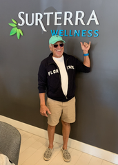 Jimmy Buffett poses for a photo Saturday at the Surterra Wellness Center on Bayou Boulevard in Pensacola.
