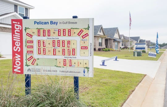 Homes for sale in the Pelican Bay subdivision in Gulf Breeze are pictured Tuesday. The Santa Rosa CountySchool District board will vote Thursday on whether to ask Santa Rosa County to re-institute impact fees to pay for new school construction.