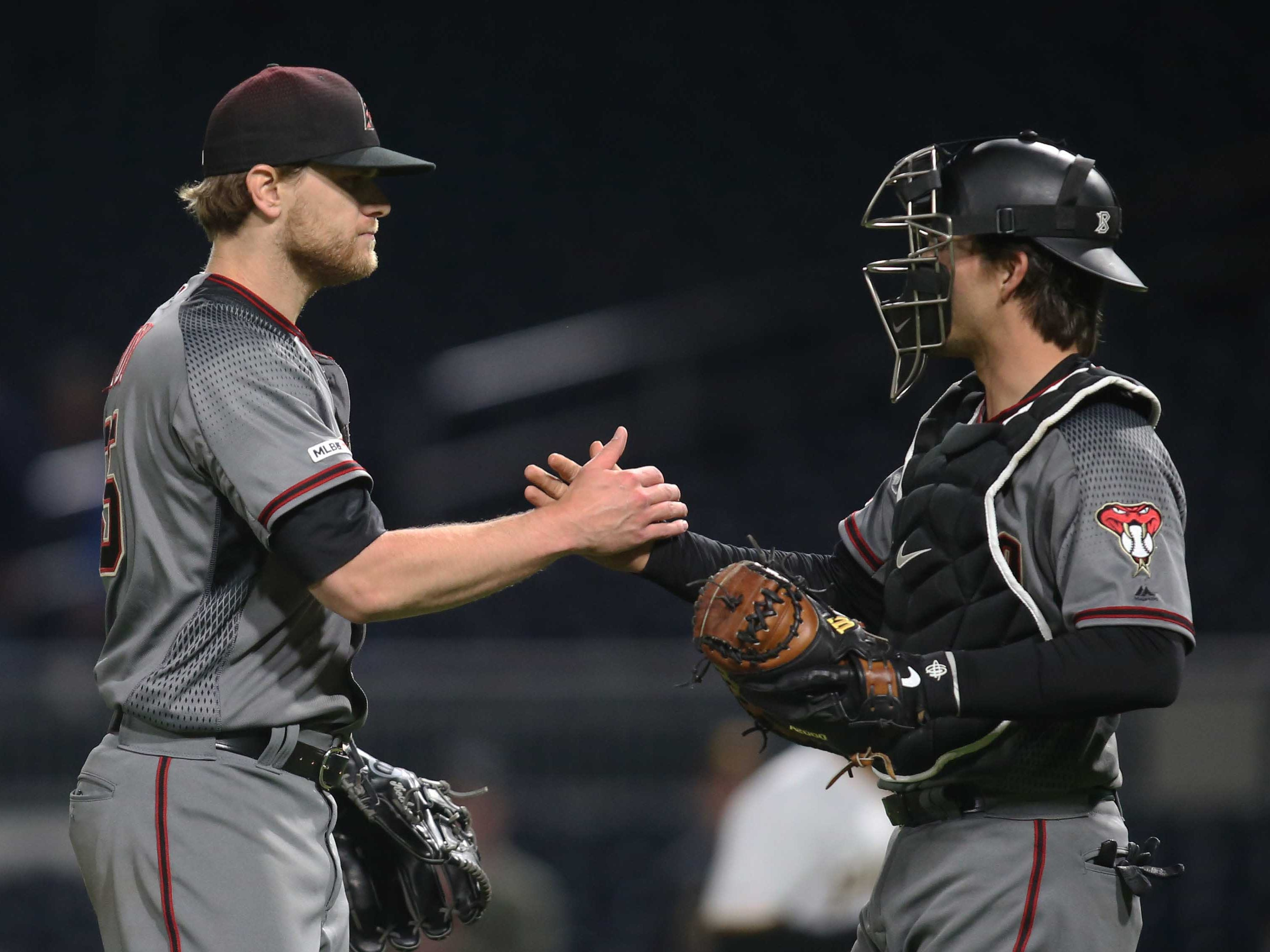 Apr 22, 2019; Pittsburgh, PA, USA;  Arizona Diamondbacks relief pitcher Matt Koch (55)  and catcher John Ryan Murphy (36) celebrate after defeating the Pittsburgh Pirates at PNC Park. Arizona won 12-4.