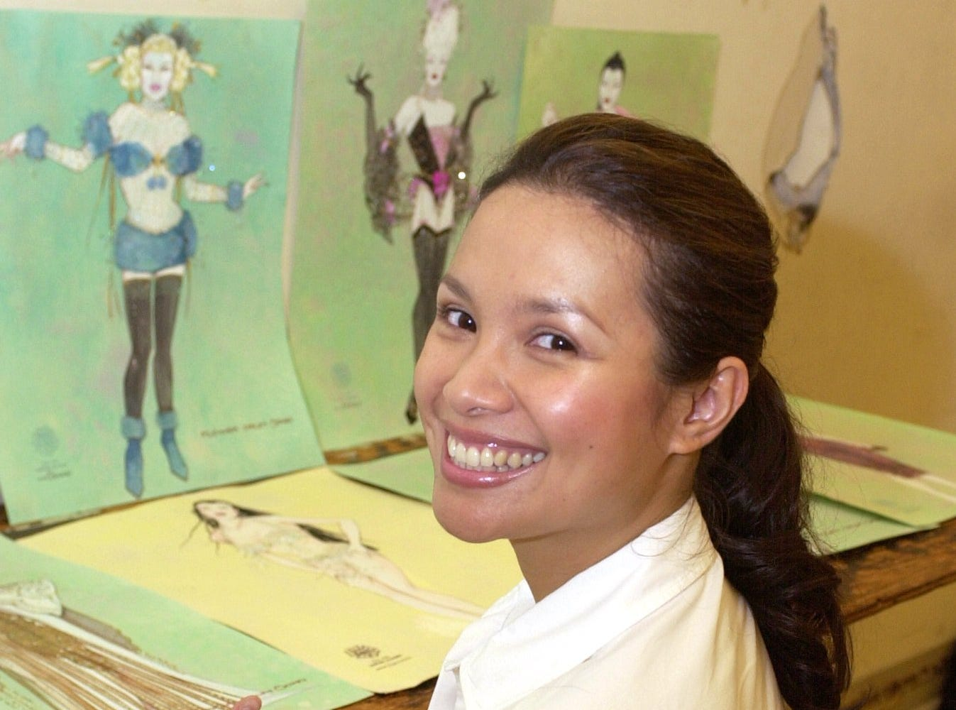 """Lea Salonga, star of """"Flower Drum Song,"""" reviews drawings of the costumes for the musical at a rehearsal in New York, Sept. 4, 2002."""