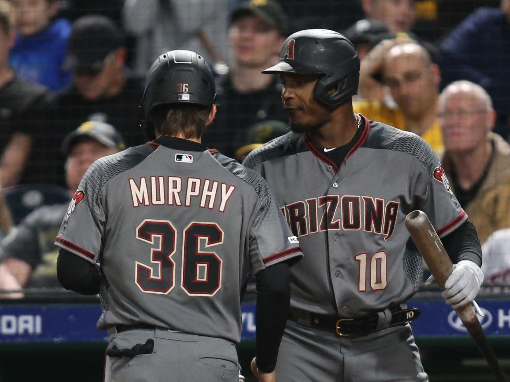 Apr 22, 2019; Pittsburgh, PA, USA;  Arizona Diamondbacks catcher John Ryan Murphy (36) celebrates with right fielder Adam Jones (10) after scoring a run against the Pittsburgh Pirates during the seventh inning at PNC Park.