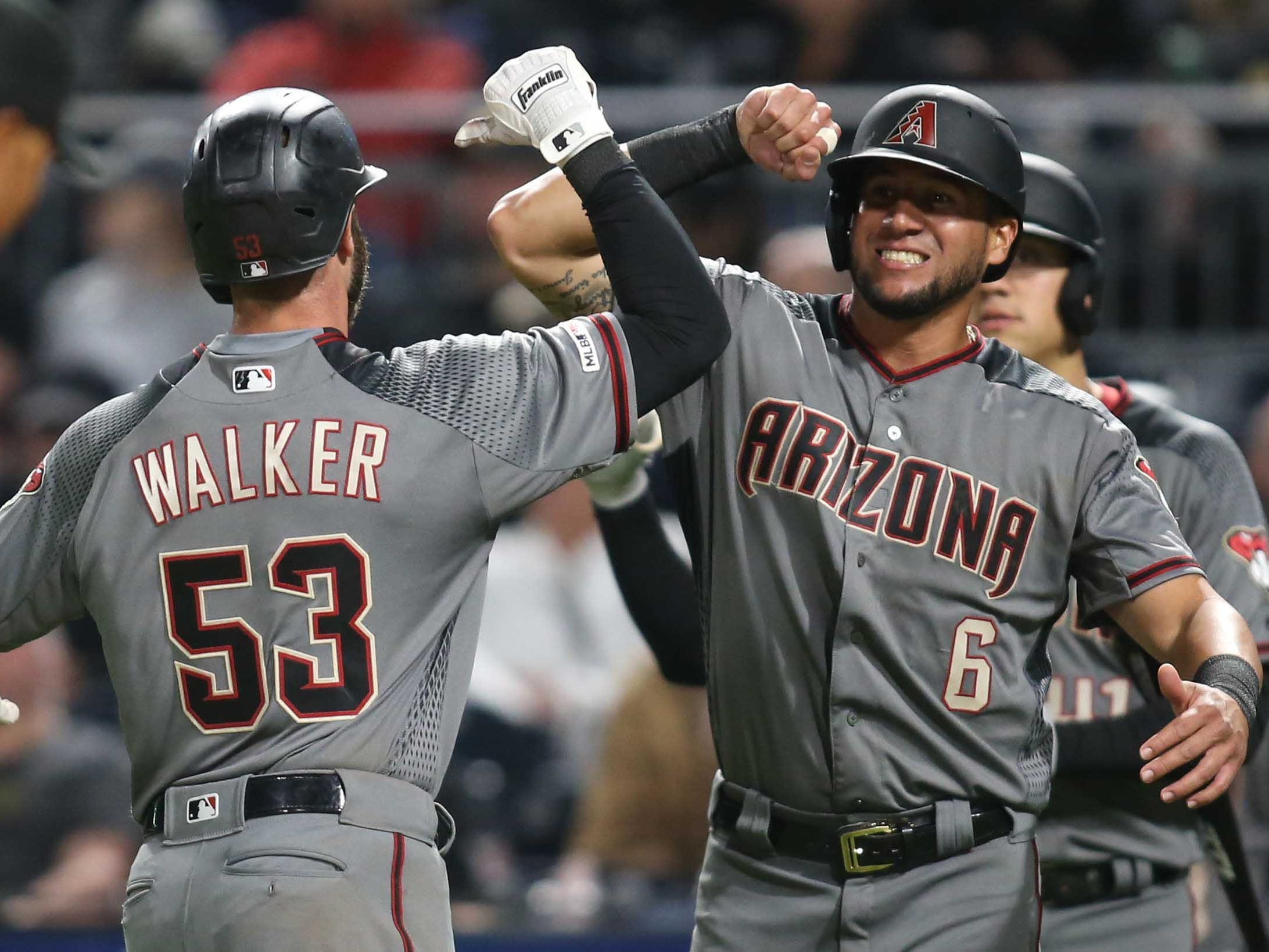 Apr 22, 2019; Pittsburgh, PA, USA;  Arizona Diamondbacks first baseman Christian Walker (53) celebrates his two run home run with left fielder David Peralta (6) against the Pittsburgh Pirates during the seventh inning at PNC Park.