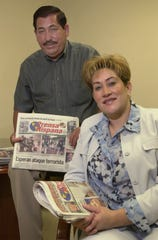 Publisher and owner Manny Garcia and CEO Lety Miranda Garcia hold up the Prensa Hispana publication on May 23, 2002.
