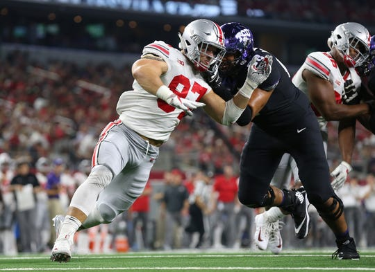 Ohio State defensive end Nick Bosa works against TCU tackle Anthony McKinney during a game at AT&T Stadium.