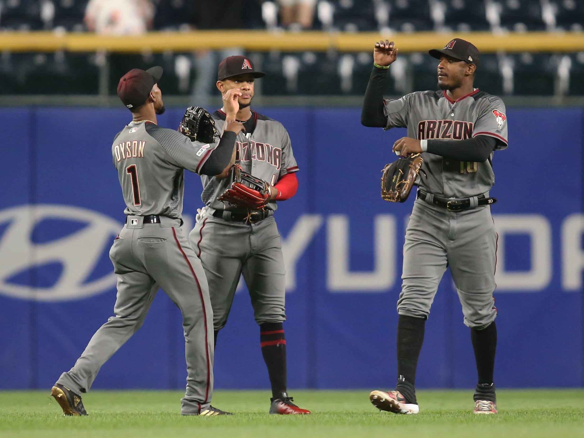 Apr 22, 2019; Pittsburgh, PA, USA;  Arizona Diamondbacks left fielder Jarrod Dyson (1) and center fielder Ketel Marte (4) and right fielder Adam Jones (10) celebrate after defeating the Pittsburgh Pirates at PNC Park. Arizona won 12-4.